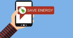 "A hand holding a smartphone with a dialog box saying ""Save Energy""."
