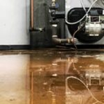 A close-up image of a leaking oil tank.